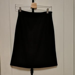 Uniqlo J+, black wool pencil skirt in size 2